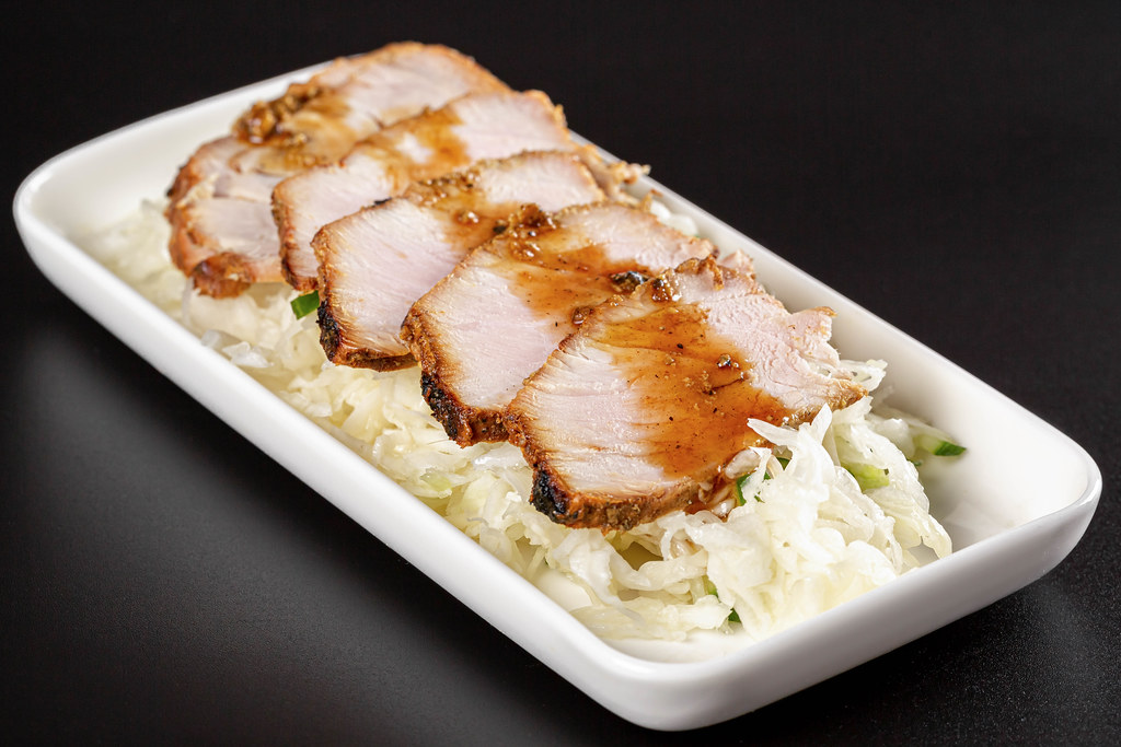 Salad with fresh cabbage with pieces of baked meat