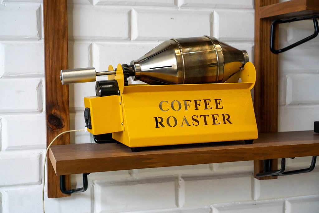 Electric Coffee Bean Coffee Roaster Machine on a Wooden Shelf in a Cafe