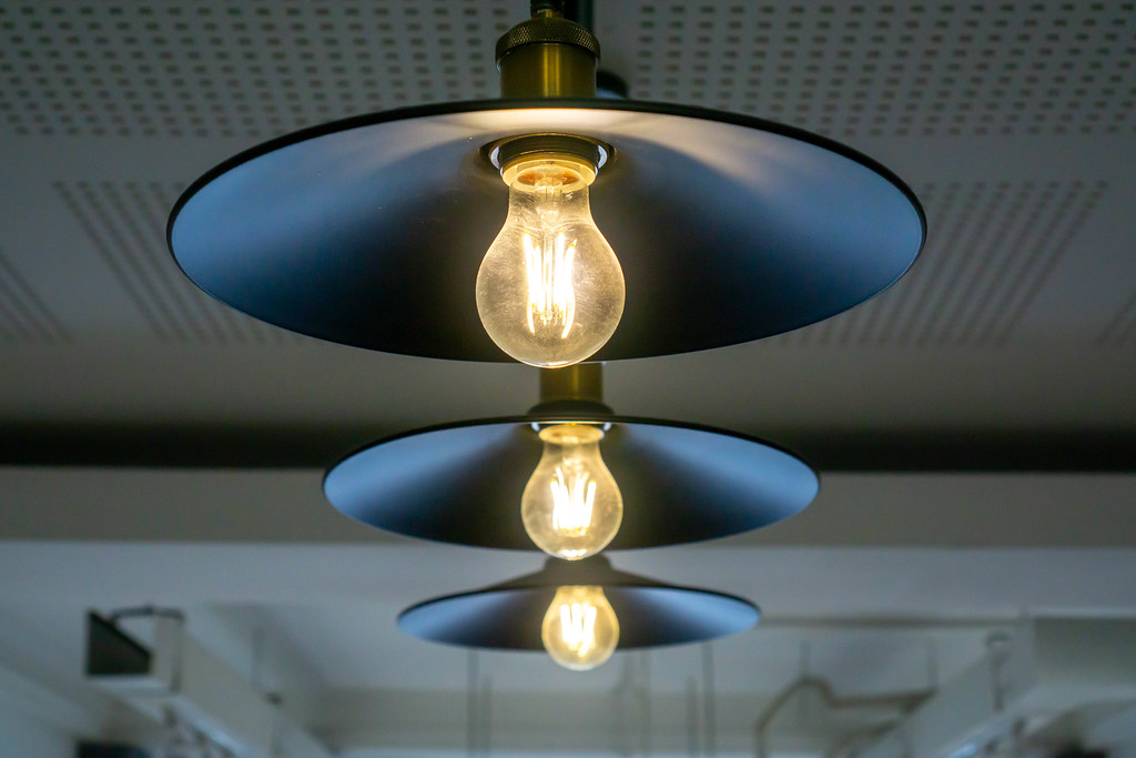 Hanging Design Lamp with Bright Light Bulbs in a modern Cafe Working Space