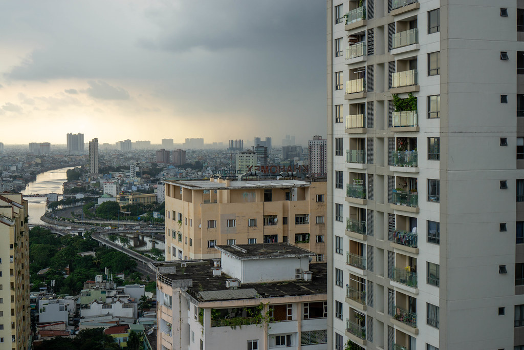 View of Ho Chi Minh City from an Apartment Building at Sunset with Rain Clouds over the City