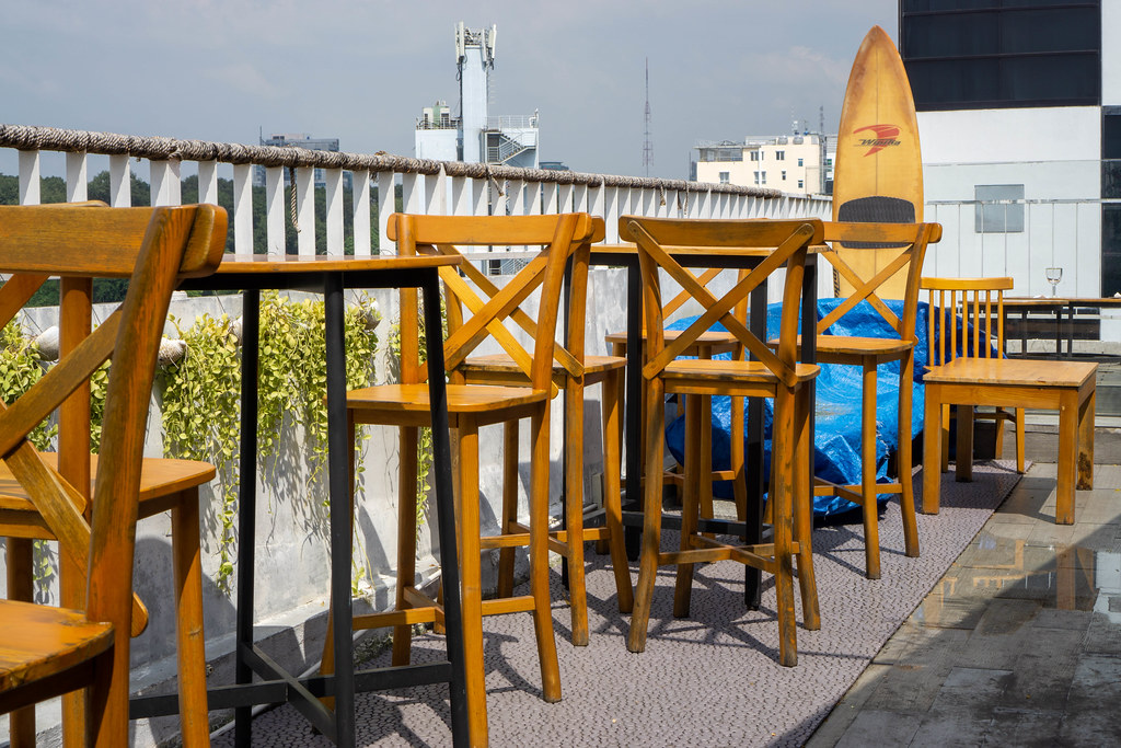 Aloha Poke & Beer Restaurant and Bar Outdoor Terrace with Wooden High Chairs and Tables in Ho Chi Minh City, Vietnam