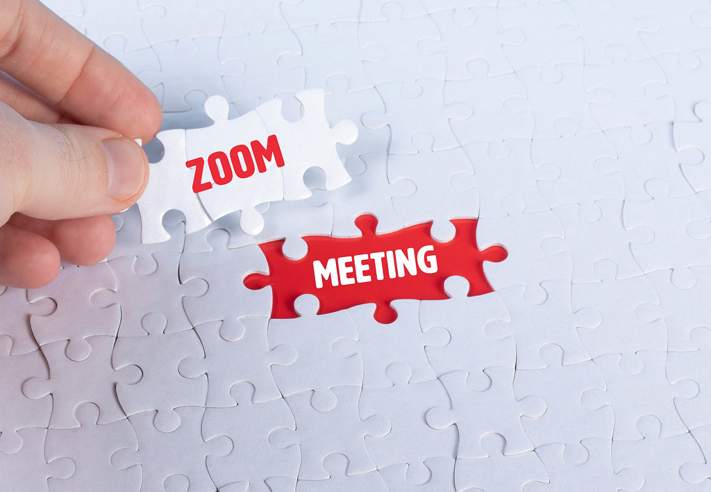 Missing puzzle pieces with a Zoom Meeting text