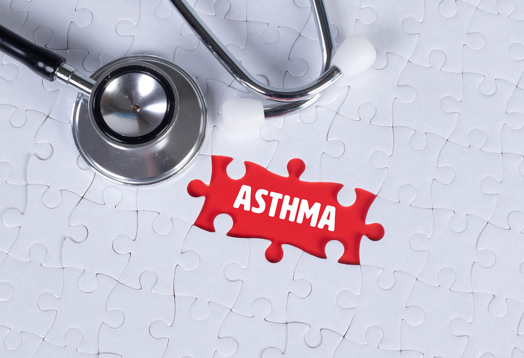 Stethoscope and missing puzzle with a Asthma text