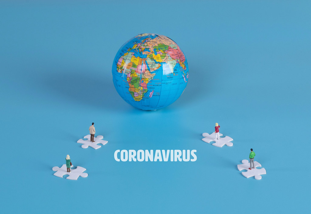 Puzzle pieces with globe and Coronavirus text