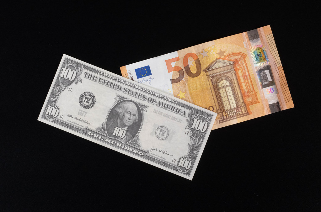 100 Dollar and 50 Euros banknote on black background