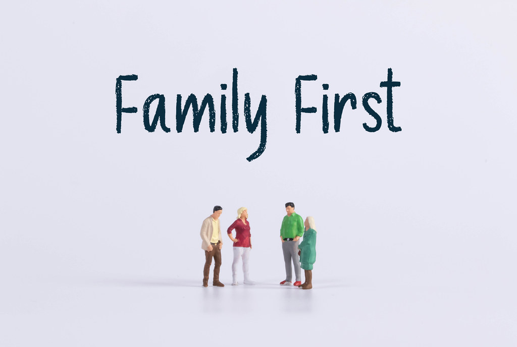Group of people with Family First text
