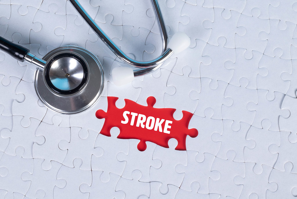 Stethoscope and missing puzzle with a Stroke text