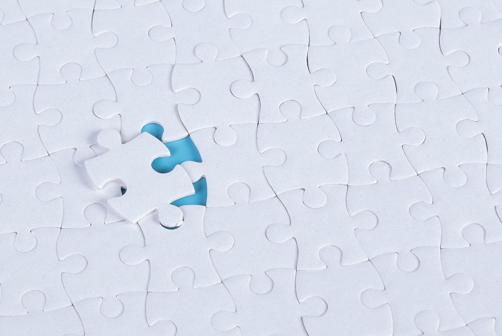 Missing puzzle piece on blue background