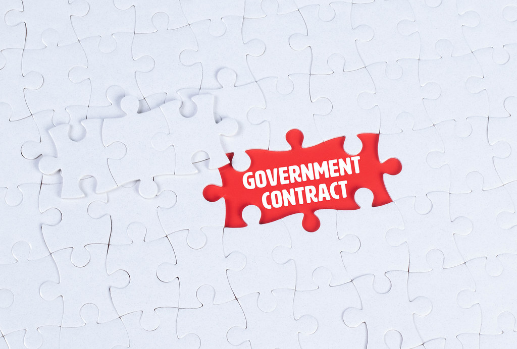 Missing puzzle pieces with a Fake Government Contract text