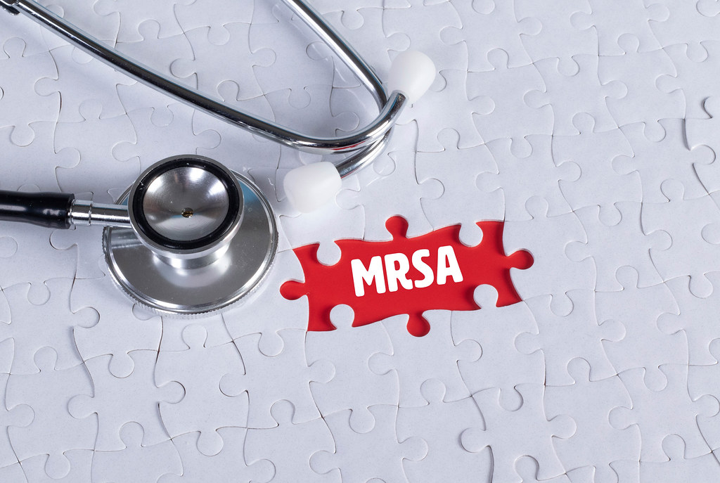 Stethoscope and missing puzzle with a MRSA text