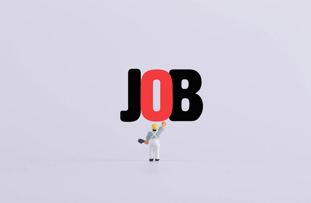 Miniature painter painting Job text