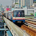 BTS Skytrain arriving at Asoke station on Sukhumvit road in Bangkok, Thailand