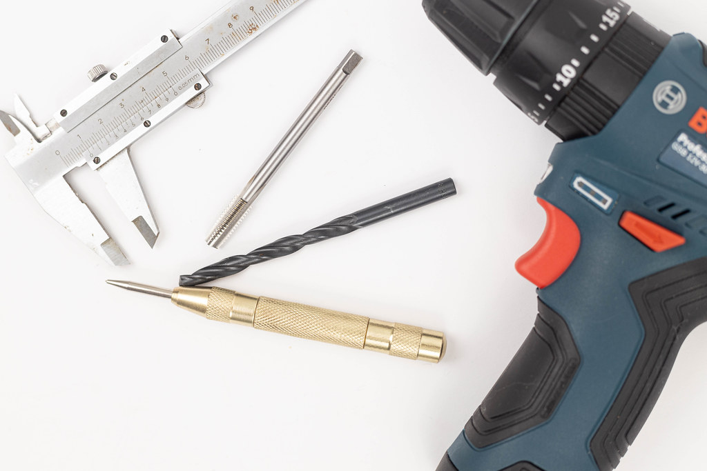 Drill with Tools isolated above white background
