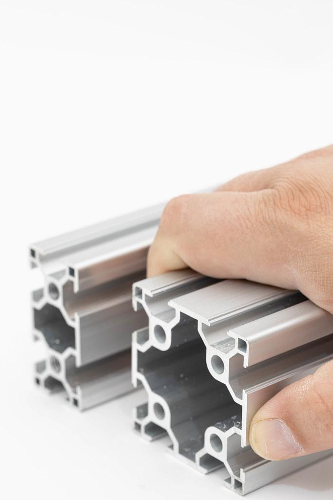 Hand on Industrial Aluminum Construction bar
