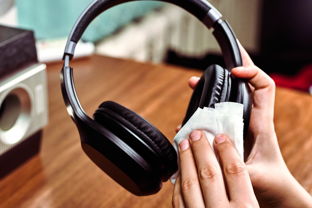 Cleaning headphones with wet wipes. Prevention of coronavirus infection