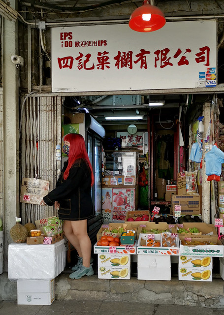 Red-haired Girl at Fruit Stand