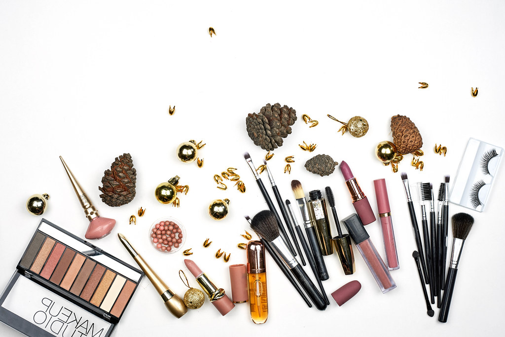 Composition with decorative cosmetics for winter season on white background