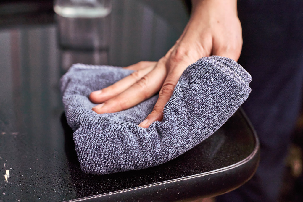 Woman disinfecting surfaces from bacteria or viruses
