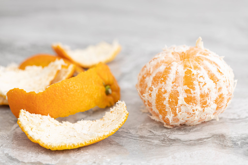 Peeled Orange on the grey table