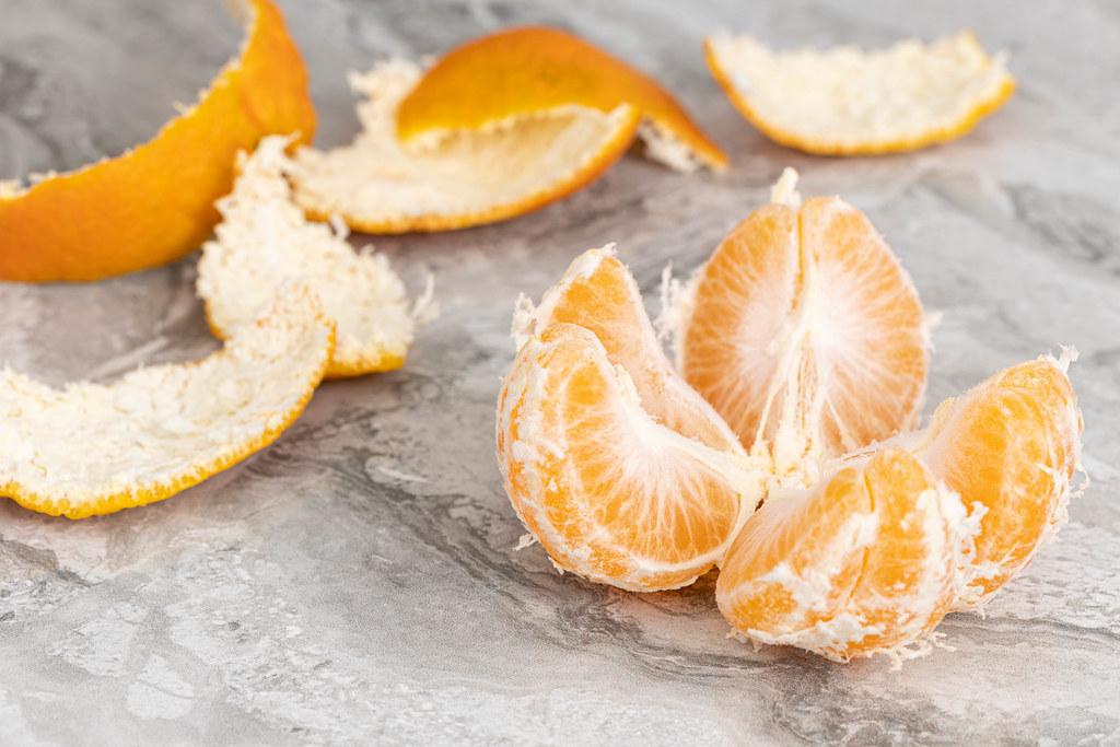 Peeled Orange sliced on the table