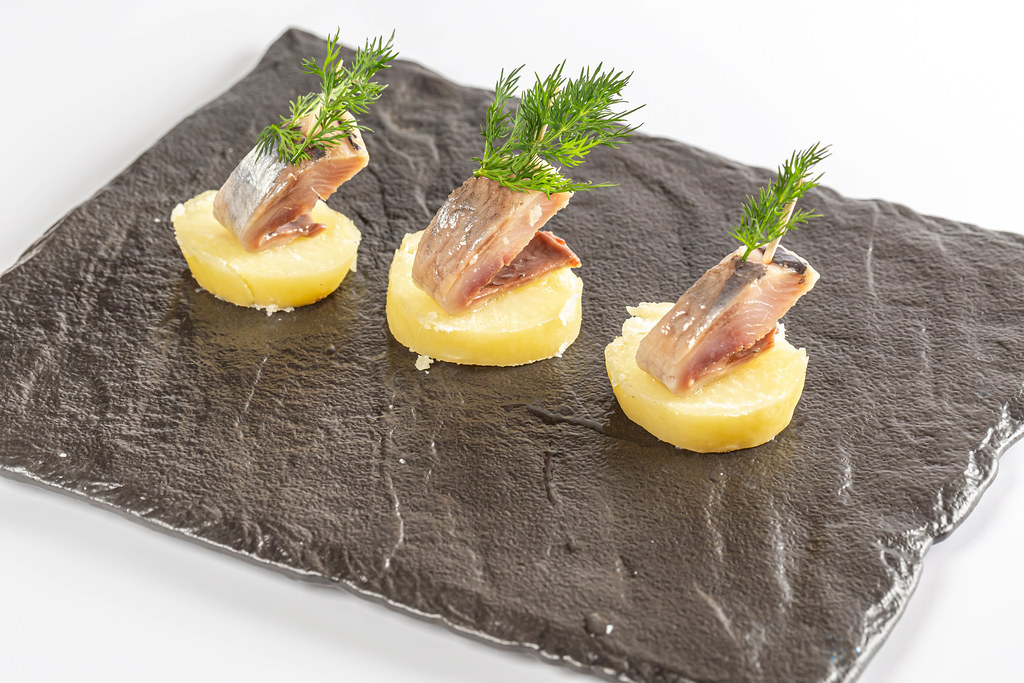 Appetizer of boiled potatoes and herring