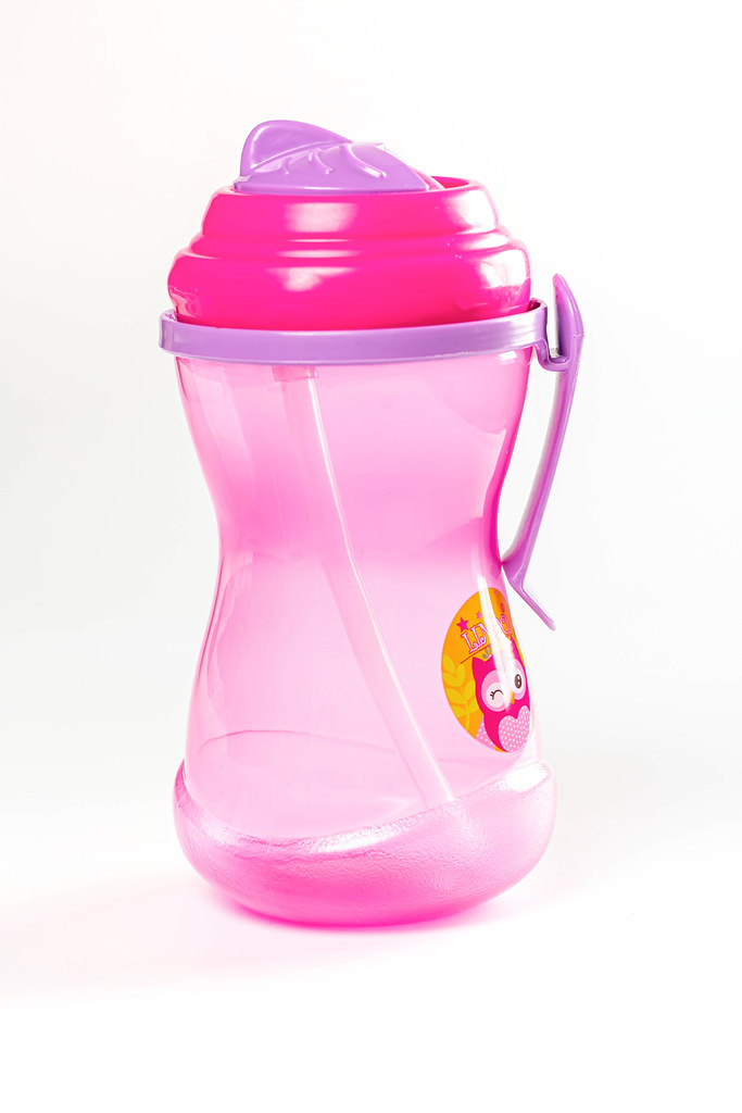Pink baby bottle with a straw