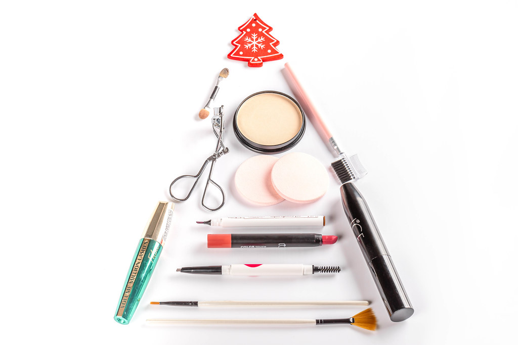 Christmas tree made from cosmetics, brushes, mascara and lipstick