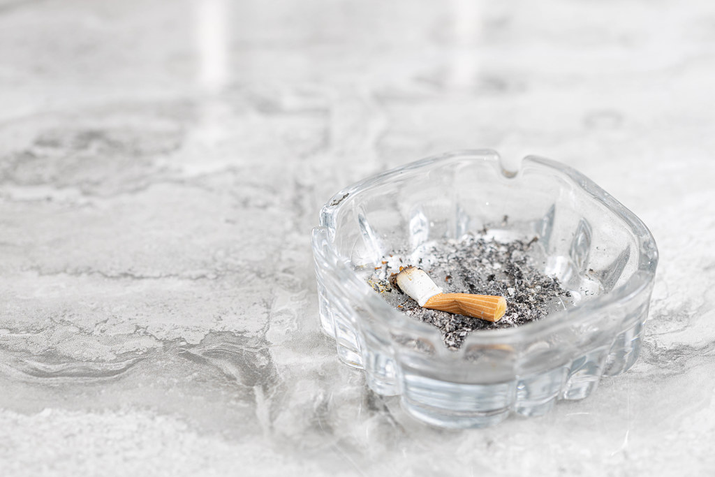 Smoked Cigarette in ashtray with copy space