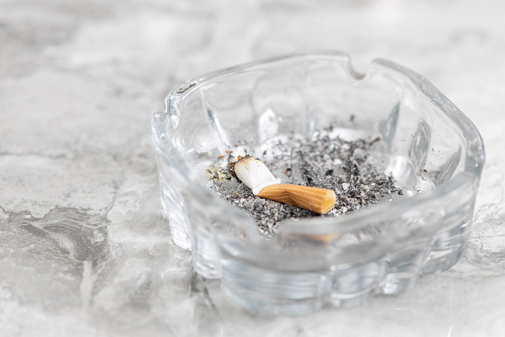 Smoked Cigarette with grey background