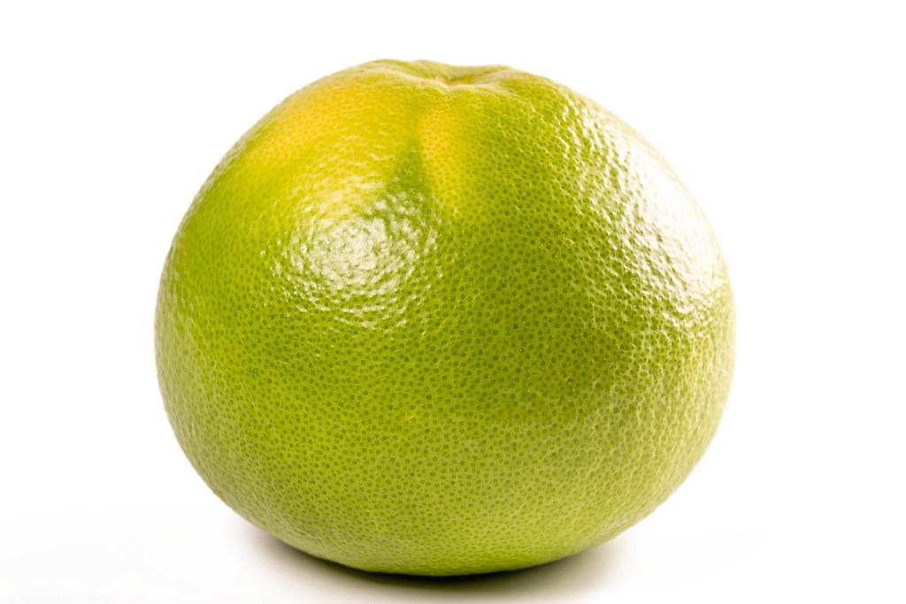 Whole fresh sweetie fruit on white