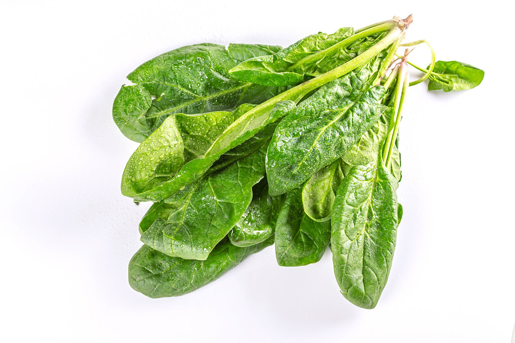 Fresh green spinach on a white background