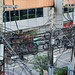 Bangkok, Thailand - November 29, 2019: Chaos of power lines on utility poles in downtown Bangkok provide electricity to the city