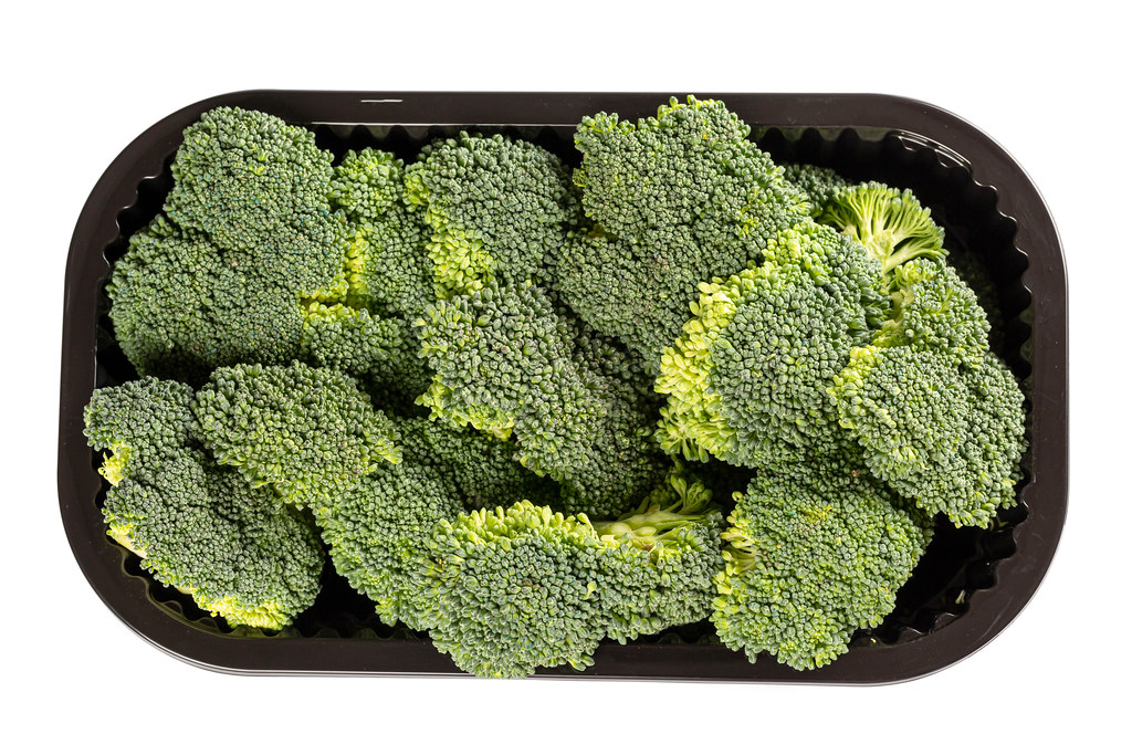 Top view, pieces of raw fresh broccoli