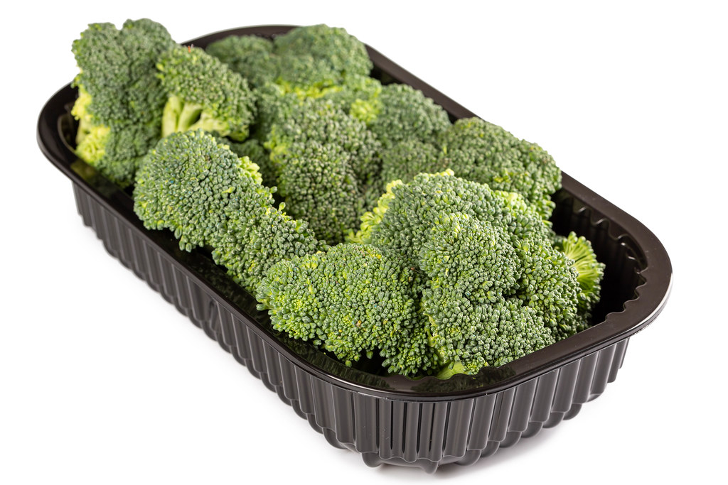Fresh ripe broccoli in a black plastic container