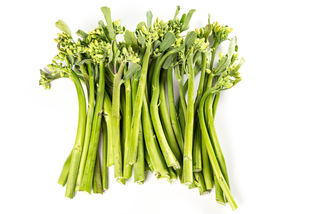 Fresh green broccolini on white background