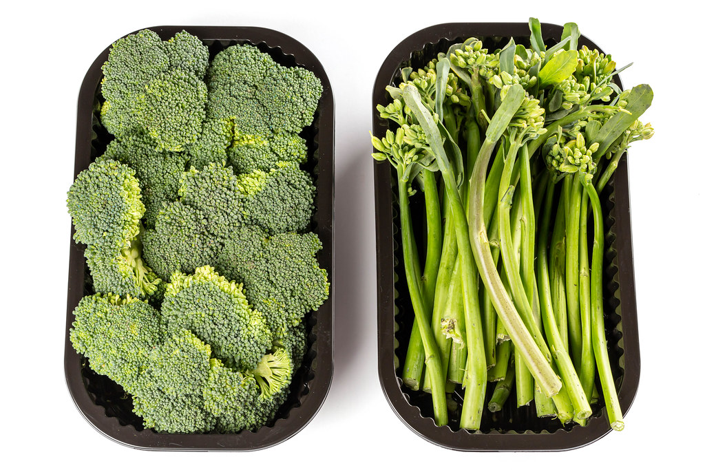 Top view of broccoli and broccolini in plastic containers