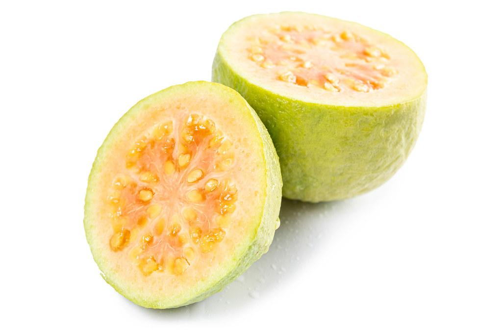 Cut two halves of a juicy guava