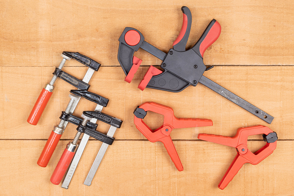 Woodworking Clamps on the wooden table background