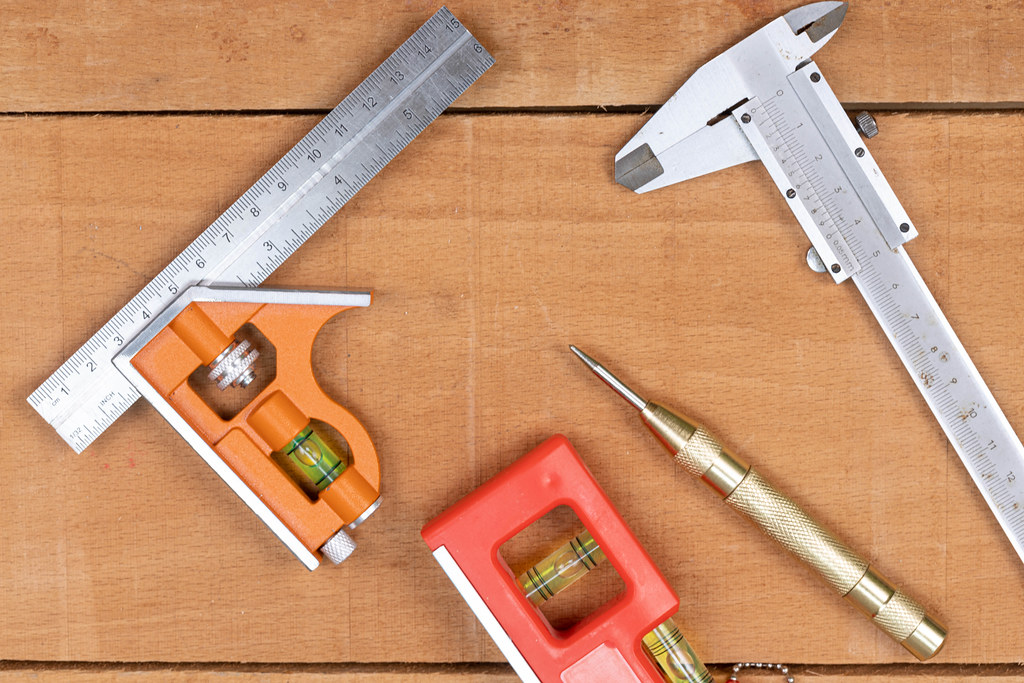 Woodworking Measuring Tools on the wooden table background