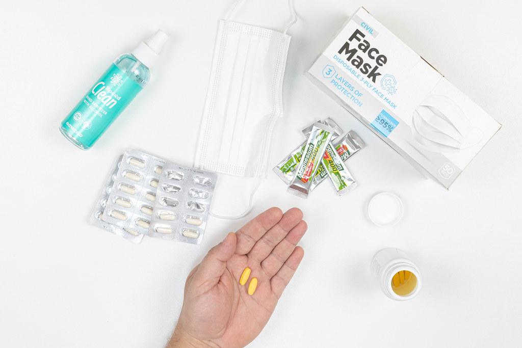 Vitamin Pills and Covid virus protection alcohol and face masks