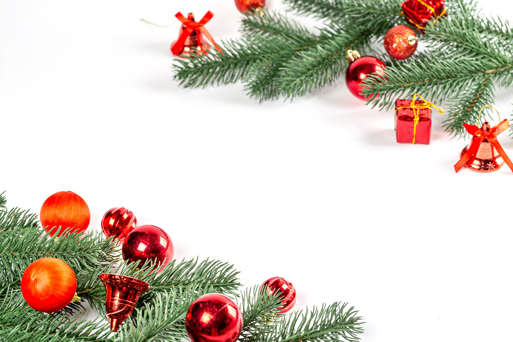 Christmas tree branches with red decor and balls