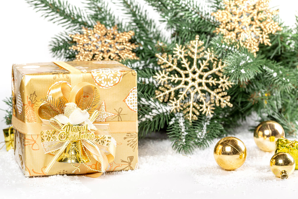Merry christmas background with golden gift and decor