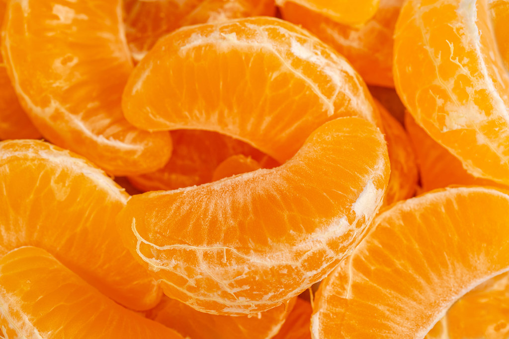 Close-up, background of tangerine slices without peel