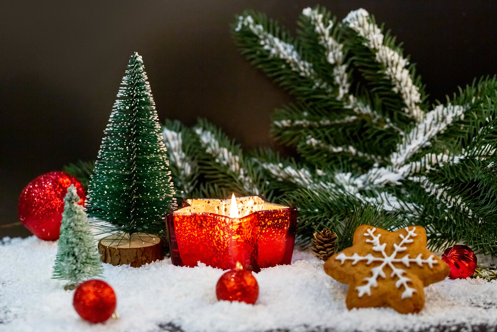 Christmas background with burning candle in a candlestick star