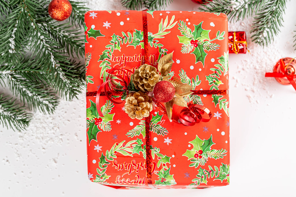 Wrapped red gift box for christmas or new years