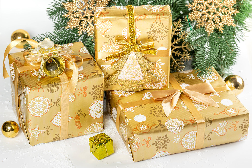 Christmas presents laid on white background with snow