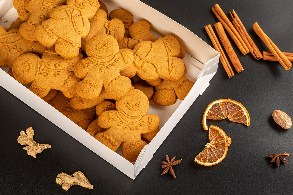 Box with gingerbread on a dark background with winter spices