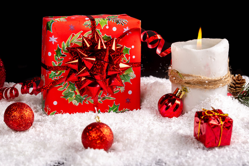Red present box with candle and xmas decor