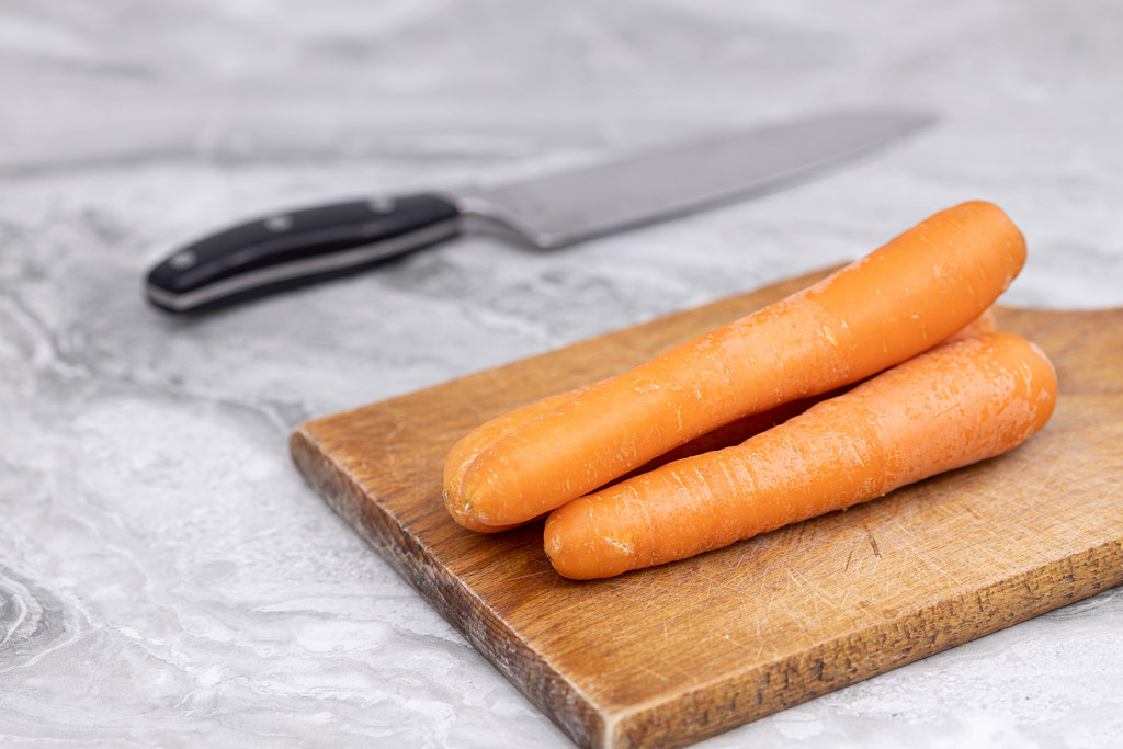 Pile of fresh Carrots on the cutting board