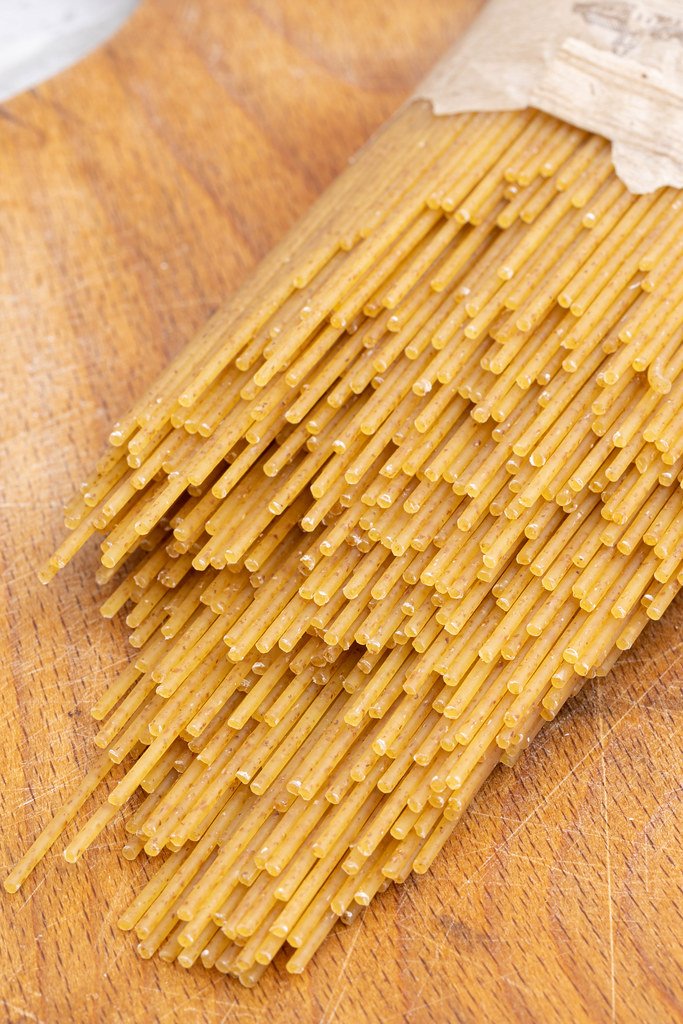 Raw Spaghetti on the wooden kitchen board